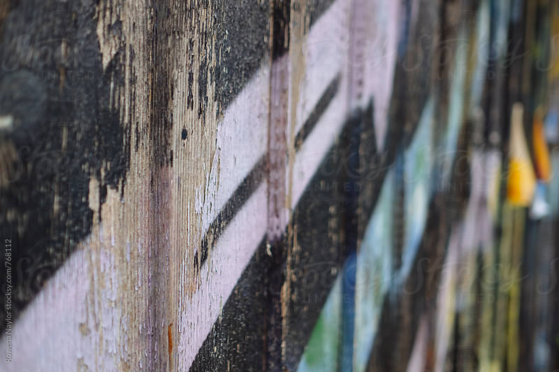Close-up of spray painted fence by Rowena Naylor for Stocksy United