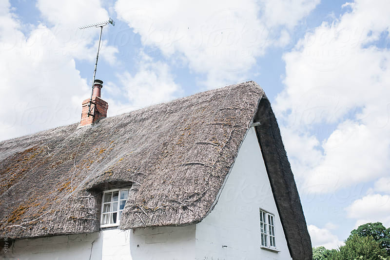 Thatched cottage by Kitty Gallannaugh for Stocksy United