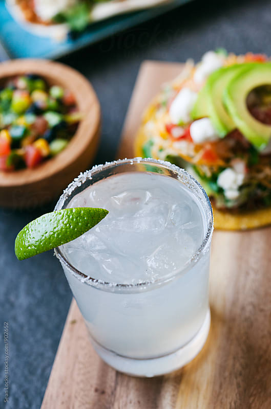 Tacos: Focus On Traditional Margarita With Foods Behind by Sean Locke for Stocksy United