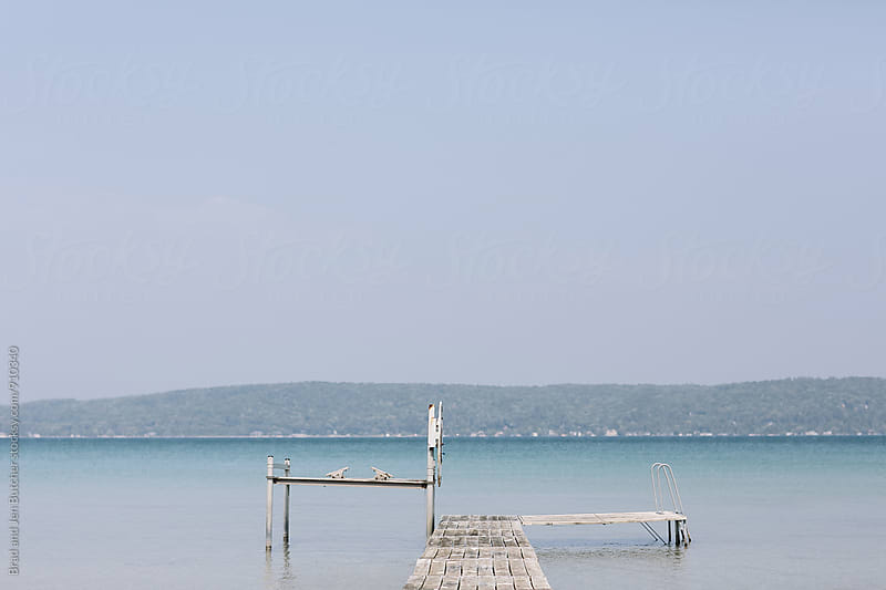 Dock in Blue Water by Brad and Jen Butcher for Stocksy United