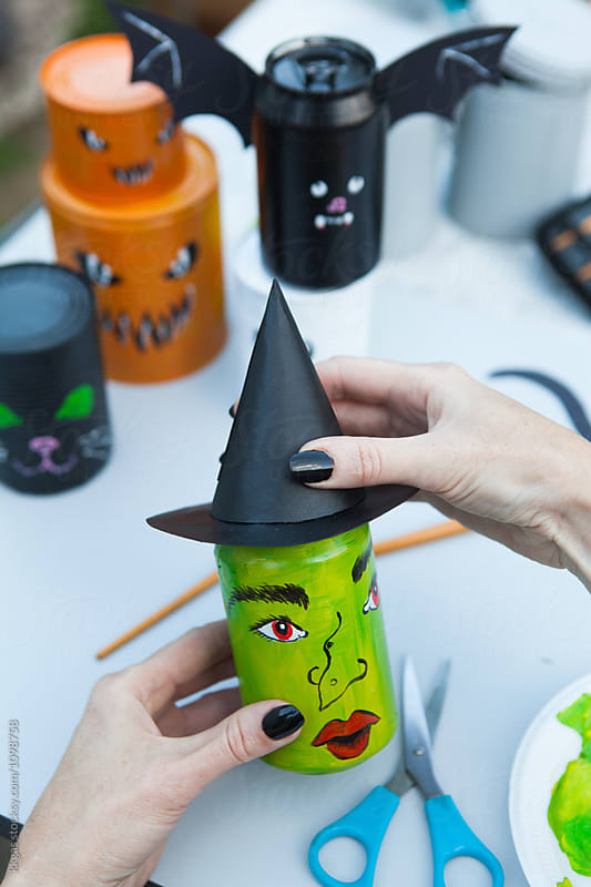 Cans being decorated for halloween games by kkgas for Stocksy United