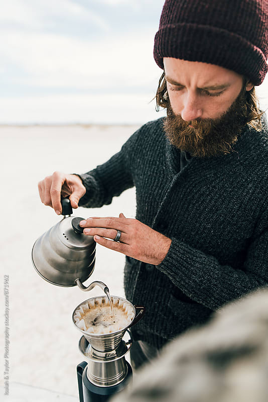 Young man making coffee by Isaiah & Taylor Photography for Stocksy United