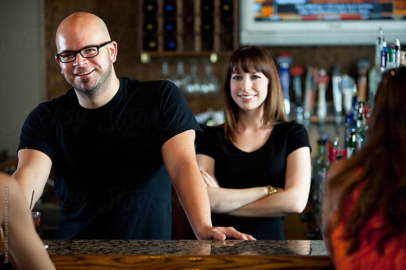 Bar: Two Bartenders Behind the Counter by Sean Locke for Stocksy United