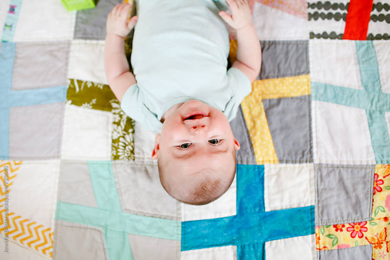 Baby laughing at camera by Jennifer Brister for Stocksy United