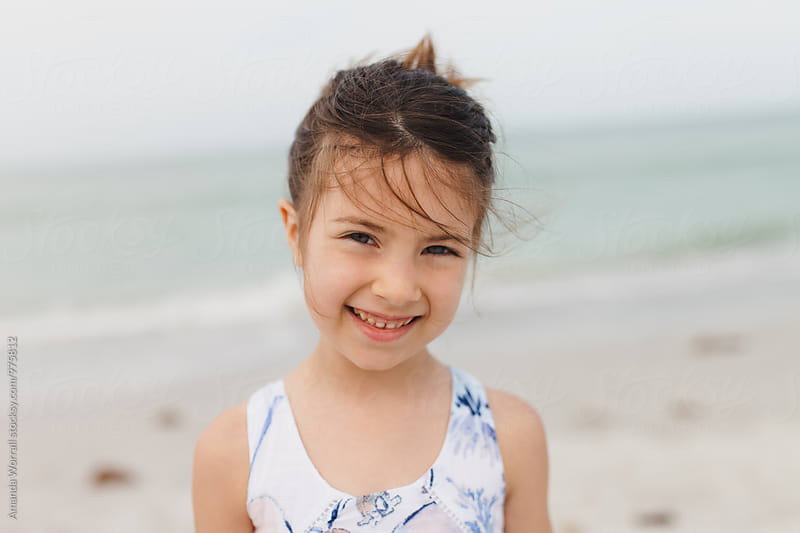 Portrait of pretty young girl at the beach by Amanda Worrall for Stocksy United