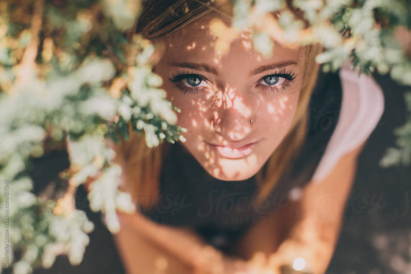 Girl Sitting in Shade  by Gabrielle Lutze for Stocksy United