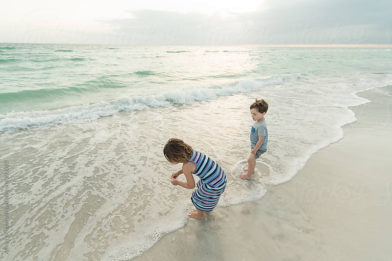 A Boy And Girl PLaying On The Beach by Alison Winterroth for Stocksy United