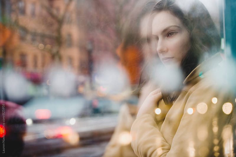 Double exposure of woman in the rain by Lauren Naefe for Stocksy United