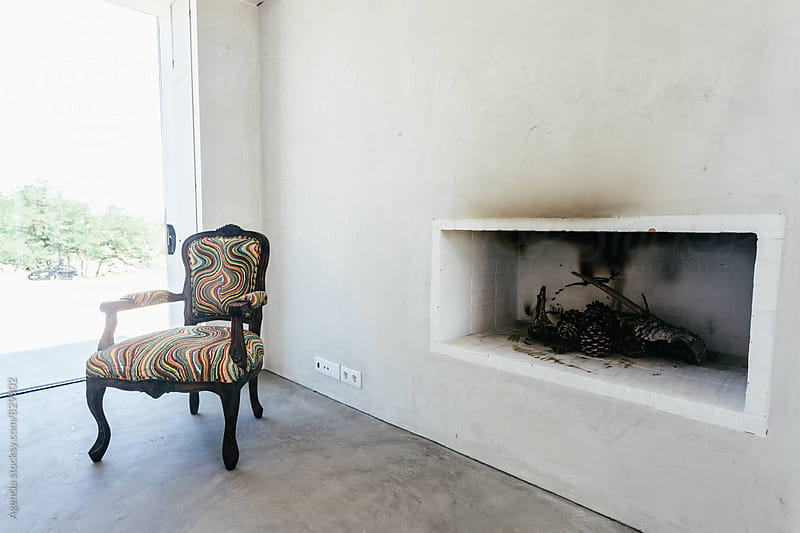 Fireplace and Chair by Agencia for Stocksy United
