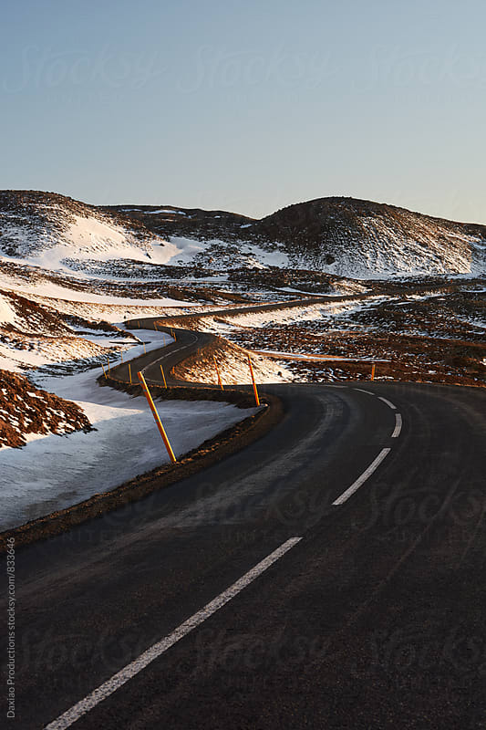 Roadtrip winding road in winter by Daxiao Productions for Stocksy United