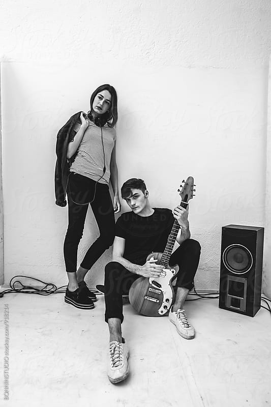Portrait of rockers couple at recording studio. by BONNINSTUDIO for Stocksy United