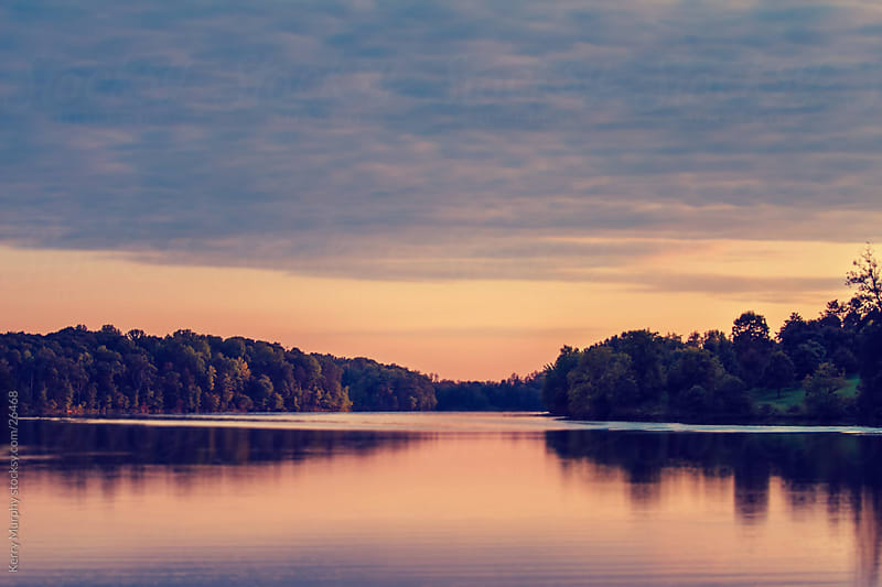 Soft sunset over lake by Kerry Murphy for Stocksy United