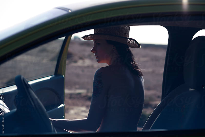 young woman in car by Rene de Haan for Stocksy United