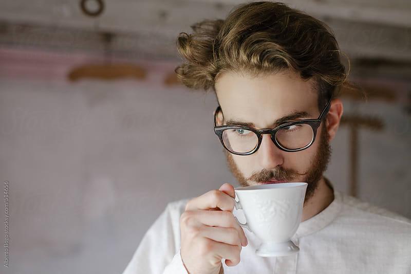 Man drinking coffee by Alberto Bogo for Stocksy United
