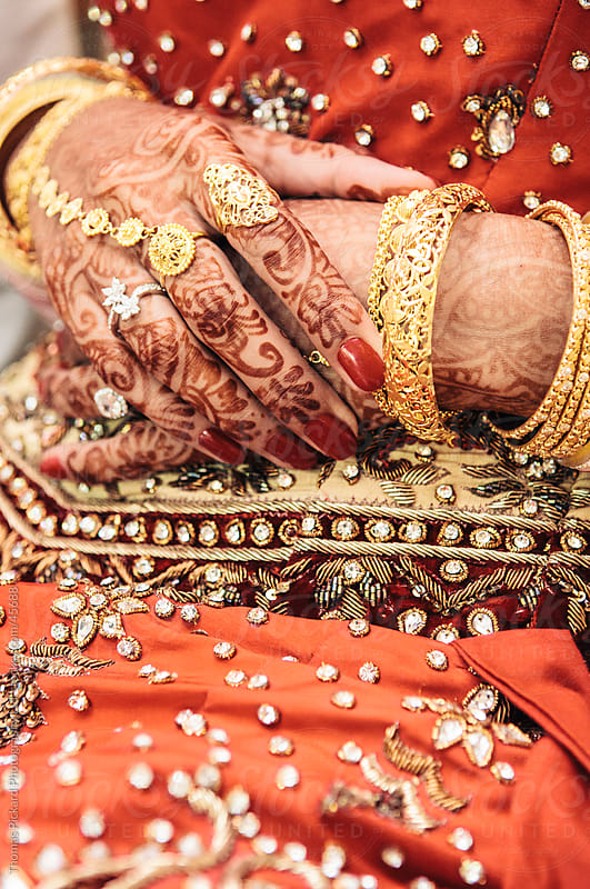 Indian woman's hands painted with henna, prior to a wedding ceremony. by Thomas Pickard for Stocksy United