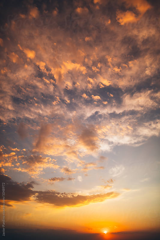 colored sunset sky  by Javier Pardina for Stocksy United