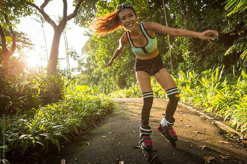 Young woman on Roller Blades by Felix Hug for Stocksy United
