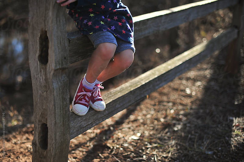Young Girl Sits on A Split Rail Fence. by Leigh Love for Stocksy United