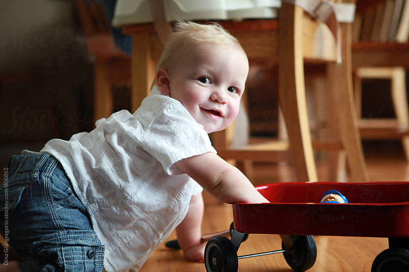 Blonde Fair Baby Boy Playing With Wagon by Dina Giangregorio for Stocksy United