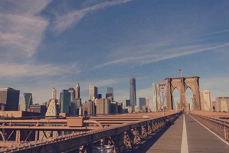 View of NYC from atop the Brooklyn Bridge  by Ron Adair for Stocksy United