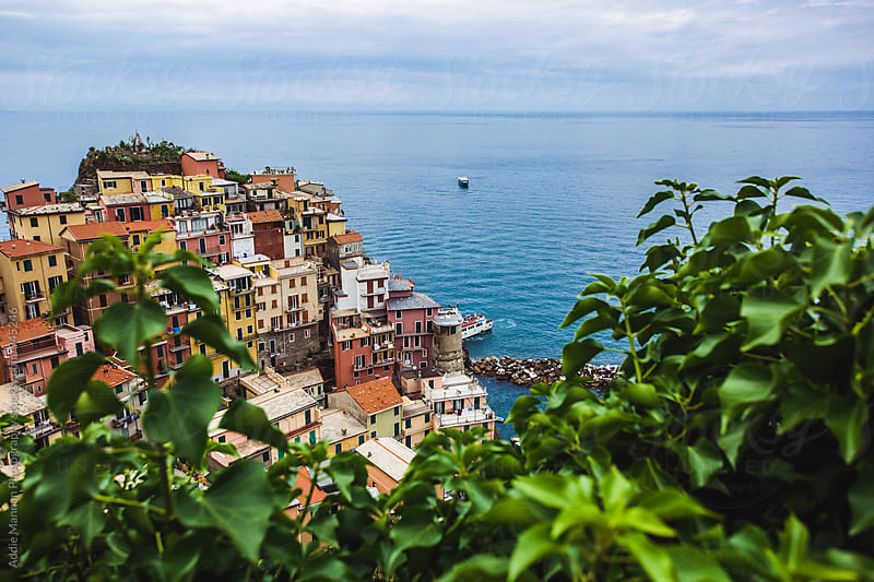 Manarola through the trees by Addie Mannan Photography for Stocksy United