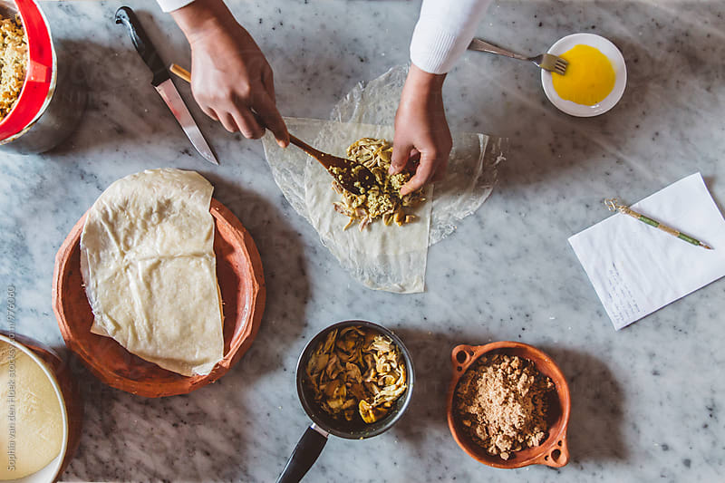 Cooking Moroccan food by Sophia van den Hoek for Stocksy United