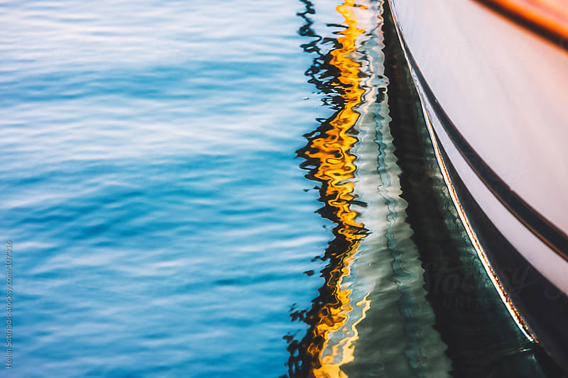 Fishing Boat Reflected in the Water by Helen Sotiriadis for Stocksy United
