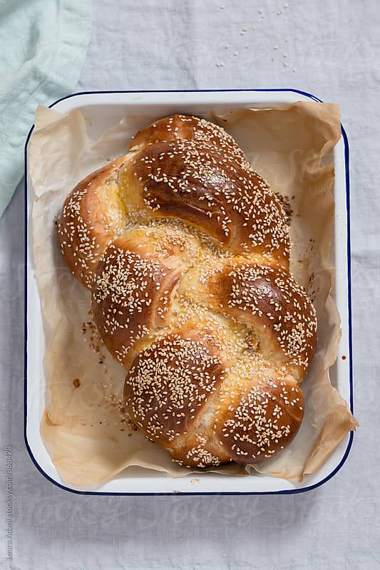 Challah, braided jewish bread by Laura Adani for Stocksy United