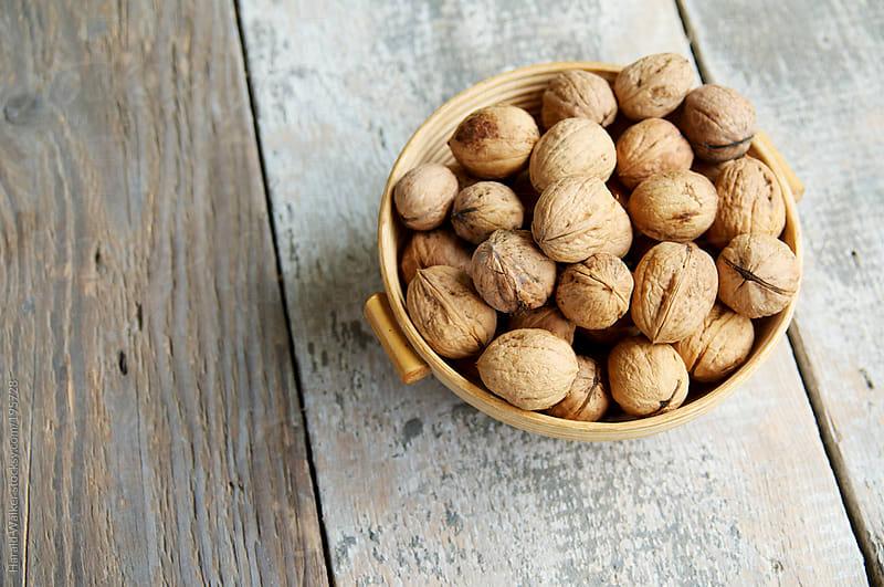 Basket of walnuts by Harald Walker for Stocksy United