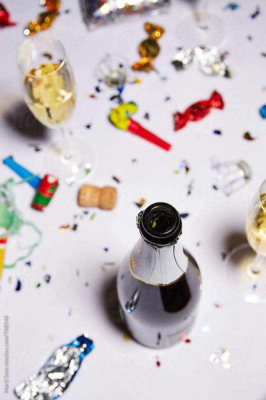 Champagne bottle in dinner party celebration  by Martí Sans for Stocksy United