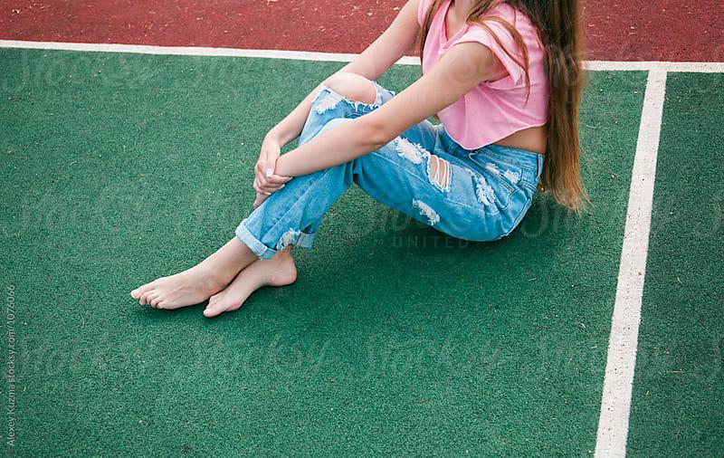 girl on the school sport field  by Vesna for Stocksy United