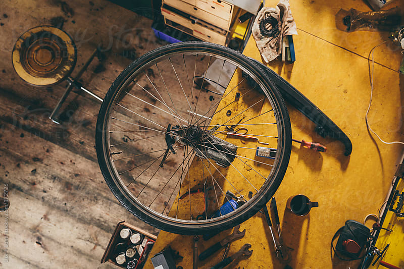 High angle shot of bicycle wheel attached to a clamp by Lior + Lone for Stocksy United