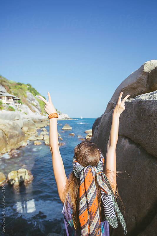 Summertime joy - woman making peace sign with her fingers by Jovo Jovanovic for Stocksy United