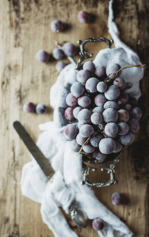 Frozen grapes by Tatjana Zlatkovic for Stocksy United