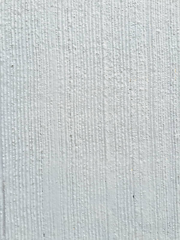 Close up of painted grey concrete wall by Paul Edmondson for Stocksy United