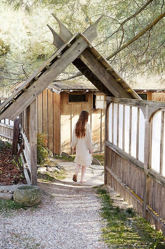 Woman walking into entrance of Japanese Spa and Hot Springs by Trinette Reed for Stocksy United