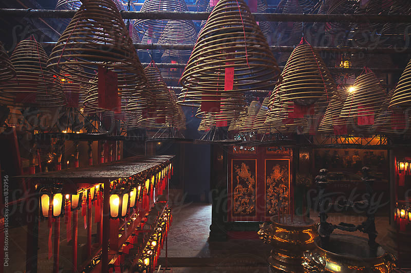 Circular incenses in Chinese temple by Dejan Ristovski for Stocksy United