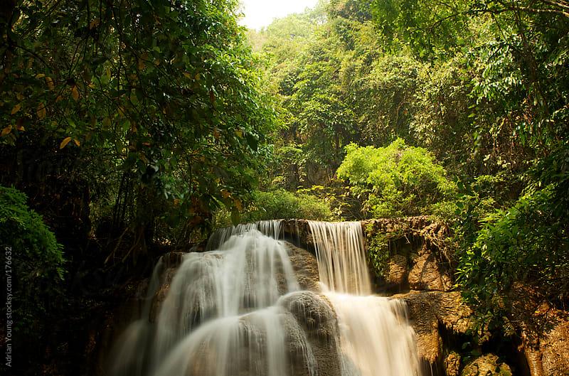 Huay Mae Khamin Waterfalls in Kanchanaburi, Thailand by Adrian P Young for Stocksy United
