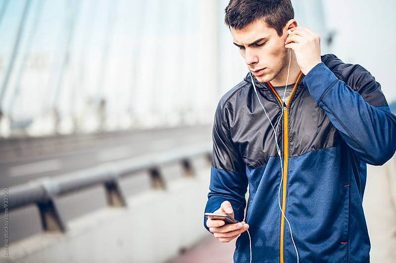 Runner Listening to Music on Mobile Phone
