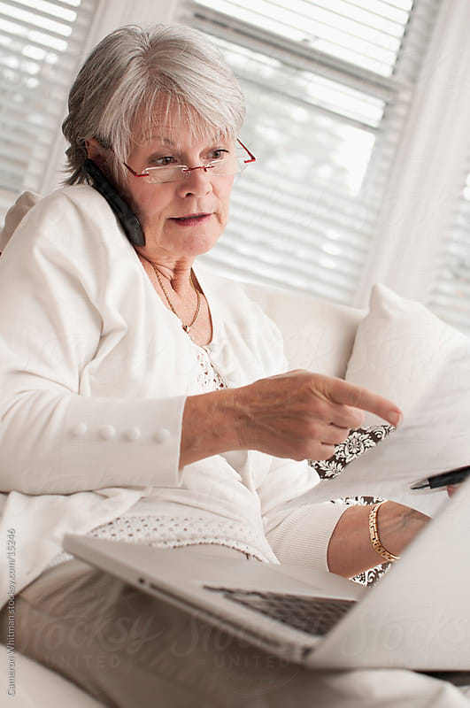 Frustrated Mature Woman On The Phone With A Billing Company by Cameron Whitman for Stocksy United