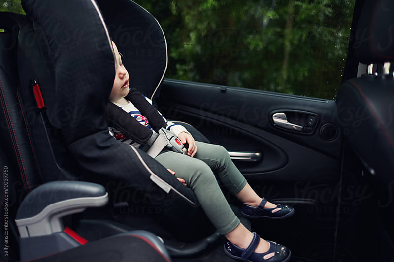 Child asleep in the car by sally anscombe for Stocksy United
