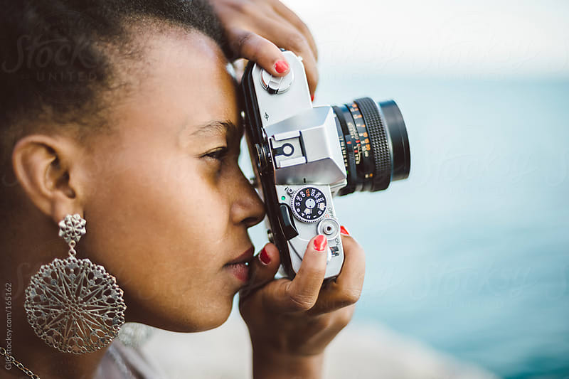 Black Young Girl using an Old Camera by GIC for Stocksy United