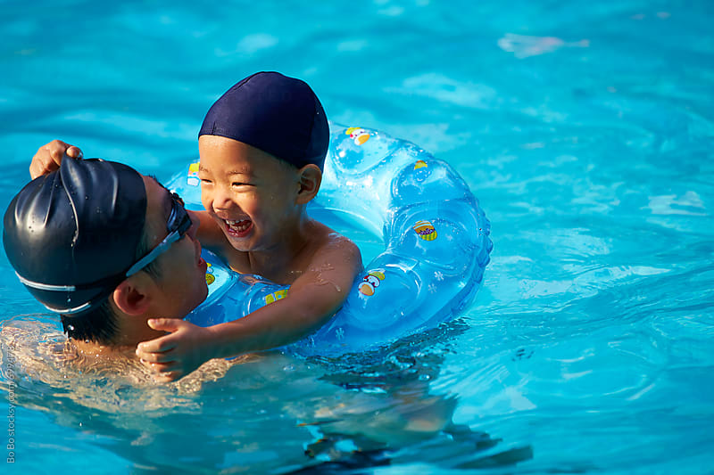 kid in swimming pool by cuiyan Liu for Stocksy United