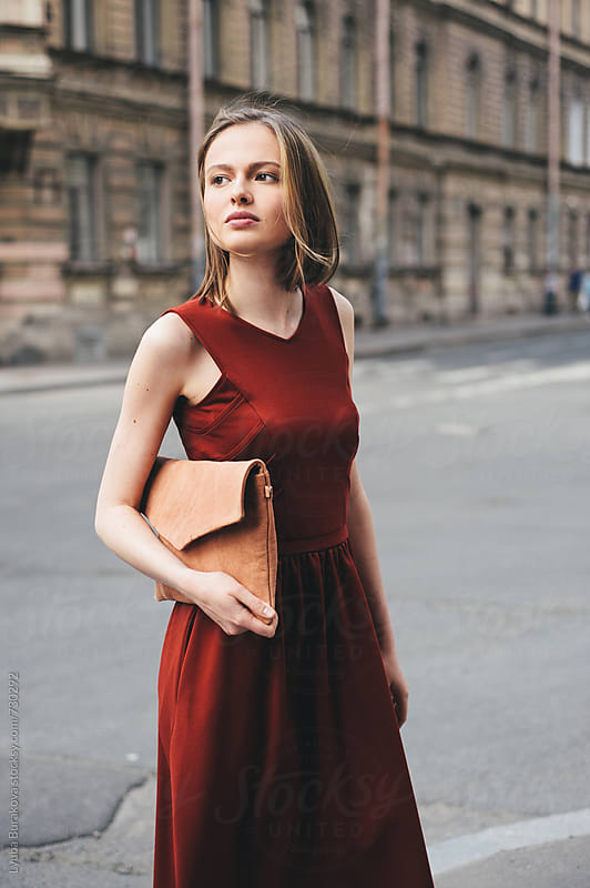 Young woman standing on the  street by Lyuba Burakova for Stocksy United