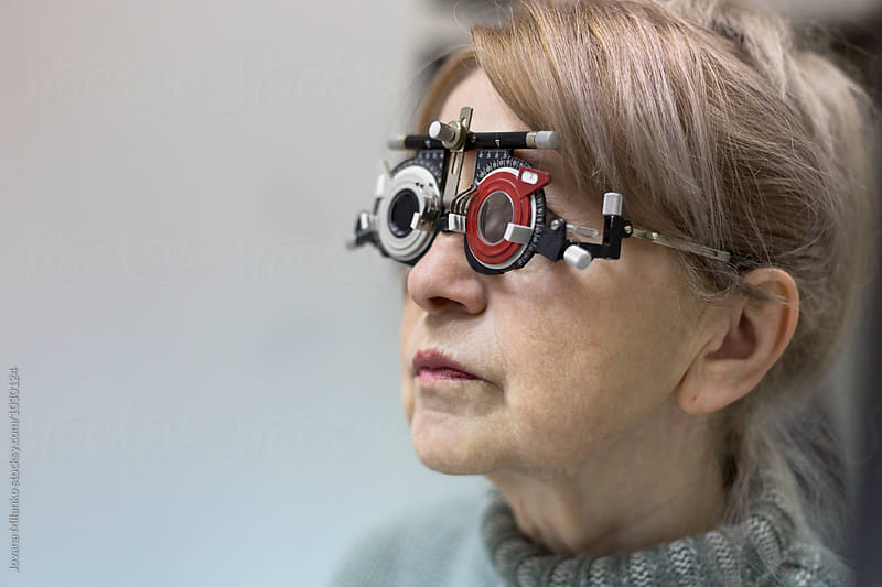 Woman wearing trial frame at ophthalmologist  by Jovana Milanko for Stocksy United