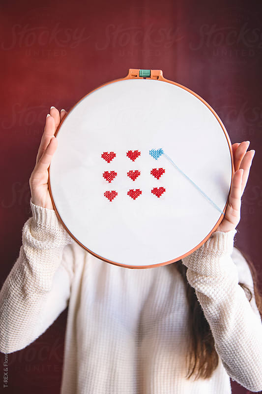 Woman holding hoop with embroidery. Incognito by Danil Nevsky for Stocksy United