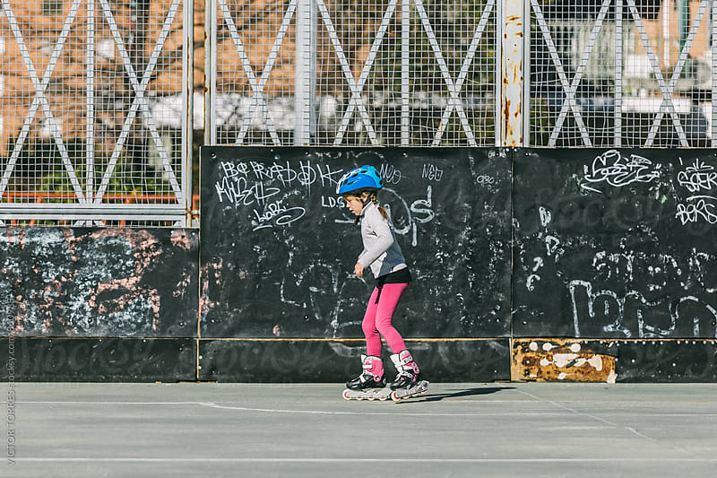 Little Girl Roller Skating in the Park by VICTOR TORRES for Stocksy United