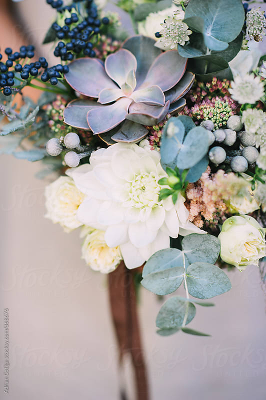 Textural green and white bouquet with succulents by Adrian Cotiga for Stocksy United