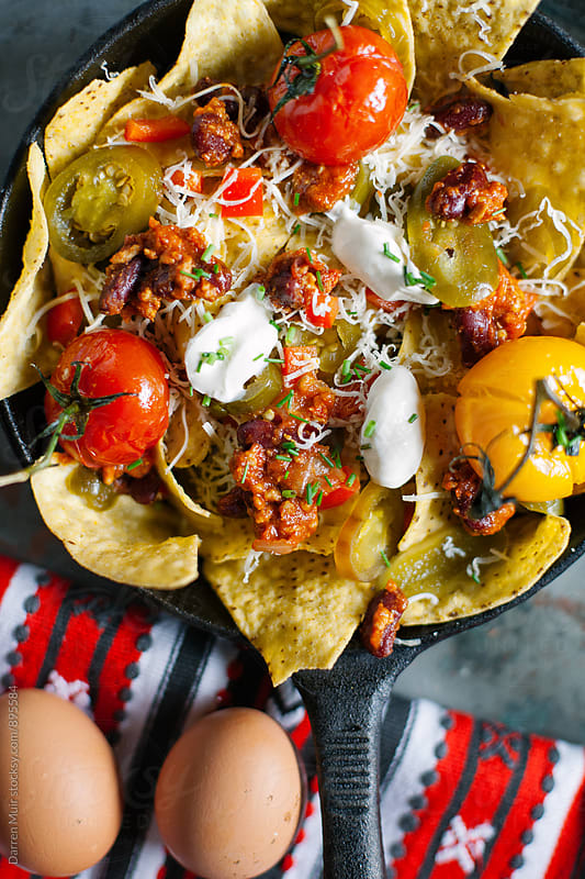 Nachos with beef chili. Seen from above. by Darren Muir for Stocksy United