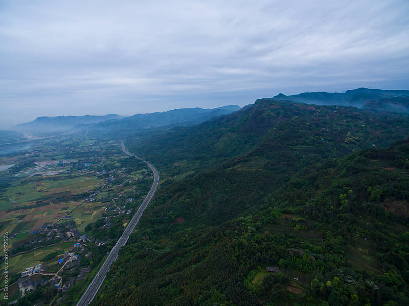 aerial view of highway under the mountain by Bo Bo for Stocksy United